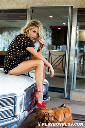 Playboy Cybergirl - Dani Mathers poses naked on a classic car