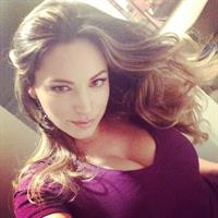 Kelly Brook taking a selfie