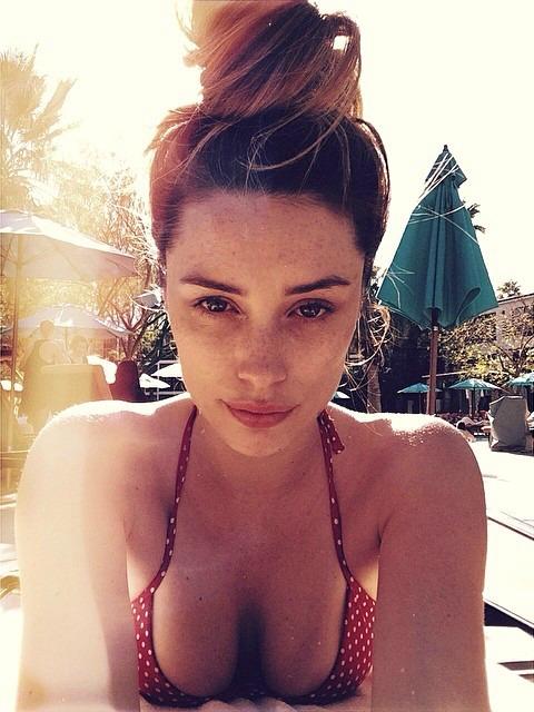 Arielle Vandenberg in a bikini taking a selfie