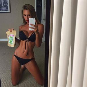 Lily Ermak in a bikini taking a selfie