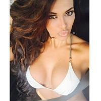 Italia Kash in a bikini taking a selfie