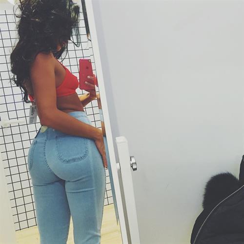 Mónica Alvarez taking a selfie and - ass