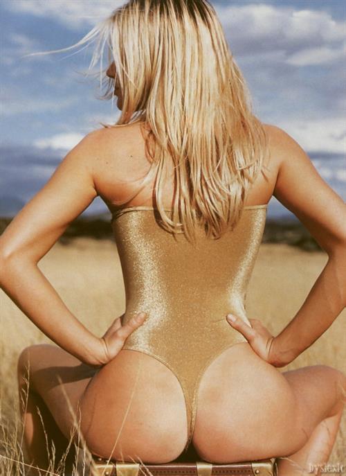 Rebecca Romijn in a bikini - ass