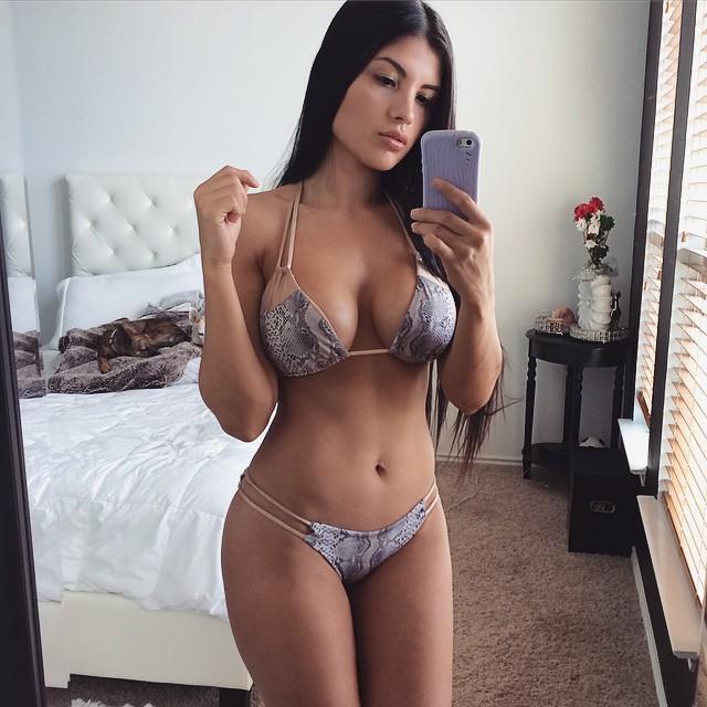 Karen Vi in a bikini taking a selfie