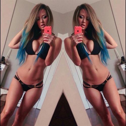 Sheala Foster in a bikini taking a selfie