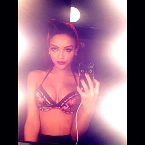 Lisa Ramos in lingerie taking a selfie