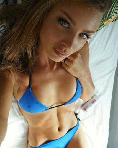 Anonymous in a bikini taking a selfie