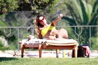 Aida Yespica - Yellow bikini candids in Sardinia on June 18, 2012
