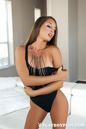 Melissa Lori takes off her black lingerie on a white couch