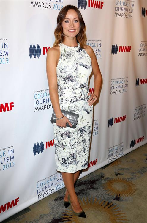 Olivia Wilde debuts her small baby bump while attending the 2013 International Women's Media Foundation's Courage in Journalism Awards at the Beverly Hills Hotel on Tuesday (October 29, 2013) in Beverly Hills, Calif.