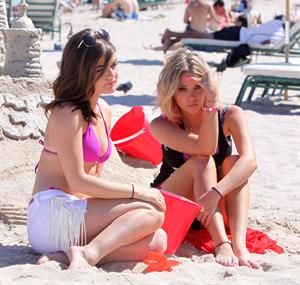 Lucy Hale and Ashley Benson photoshoot at the Bondo Bikini Shack on Miami Beach on March 24, 2012