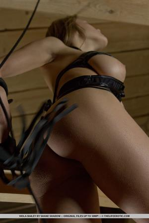 Viola Bailey in leather straps
