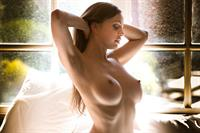 Abigail Mac shines in the sunlight from a window