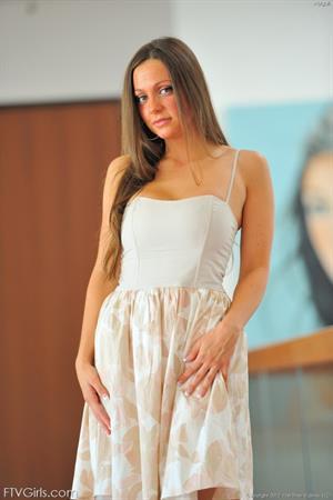 Abigail Mac in a white dress