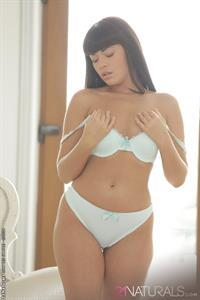 Ava Delush takes off lingerie