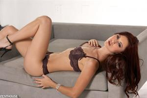 Karlie Montana in dark lacy lingerie in this Penthouse photoshoot