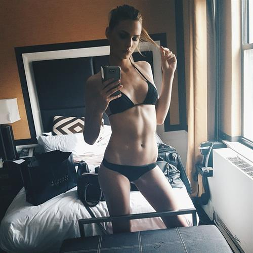 Andreja Pejić in a bikini taking a selfie