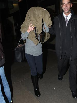 Selena Gomez arrives on a flight at Los Angeles Airport December 21, 2012