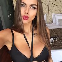 Viktoria Odintsova in a bikini taking a selfie