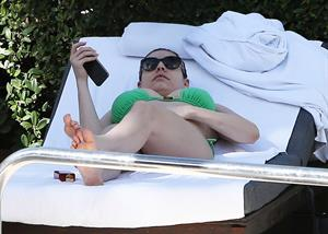 Kelly Brook bikini candids by the pool in Miami 2/1/13
