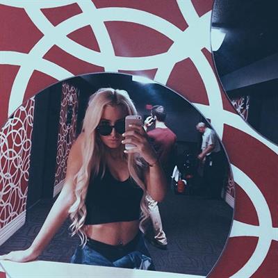 Tana Mongeau taking a selfie