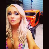 Krystal Dawson in a bikini taking a selfie