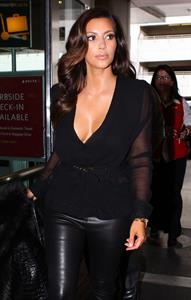 Kim Kardashian arriving at airport in Miami 10/17/12