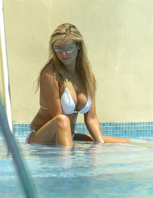 Abi Titmuss in a white bikini with a friend
