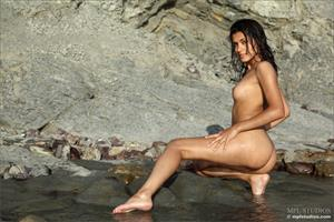 Belinda A strips off her bikini by and outdoor stream