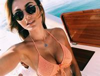Karen Lima in a bikini taking a selfie