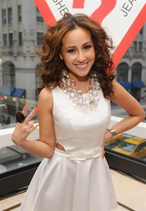 Adrienne Bailon grand opening of the new 5th avenue flagship store on April 20, 2011