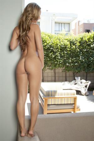 Playboy Cybergirl Nicole Banks Nude on a sofa