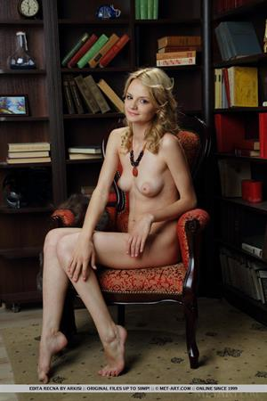 Edita Recna nude in a library for Met-Art