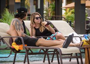 Ashley Benson – poolside vacation in Cancun 11/13/13
