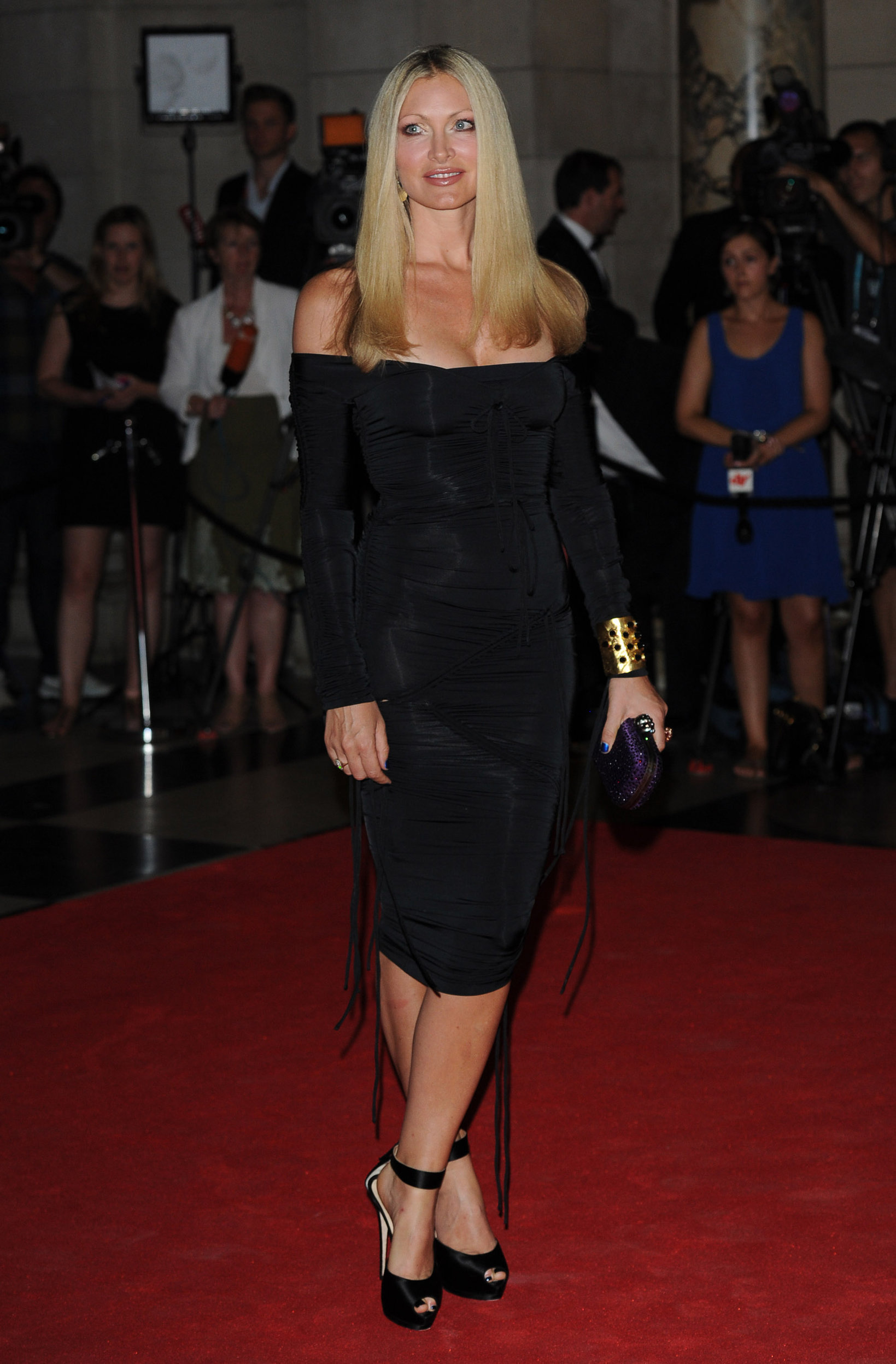 Caprice Bourret in a black dress