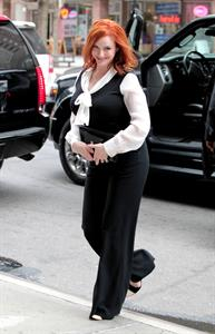 Christina Hendricks opening bell of New York Stock Exchange on March 21, 2012