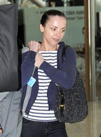 Christina Ricci With her boyfriend fly out of Heathrow Airport in London to NY - June 12, 2012