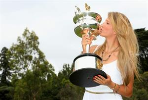 Victoria Azarenka poses with Memorial Cup after winning the 2013 Australian Open January 27, 2013