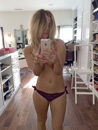 Kaley Cuoco taking a selfie and - breasts