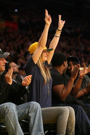 Kaley Cuoco attending a Los Angeles Lakers vs New York Knicks basketball game in LA on December 29, 2011