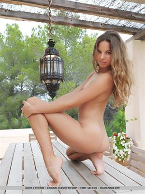 Altea B in  Dicosra  for MetArt - A naked and confident Altea B poses on the wooden deck.