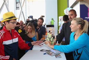 Maria Sharapova Sugarpova stand during day five of the Mutua Madrid Open tennis tournament May 8, 2013