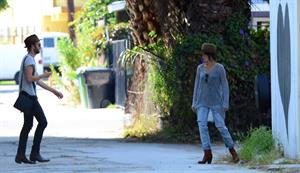 Nikki Reed spotted in ripped jeans in Venice (05.06.2013)