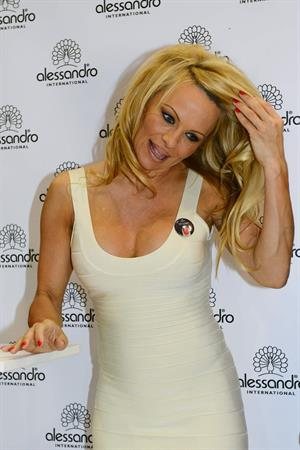 Pamela Anderson  Presents Striplac Nail Polish at Beauty Fair Düsseldorf  March 15, 2013