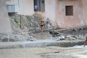 Kimberley Garner in a black bikini on the beach in St. Tropez on July 31, 2014