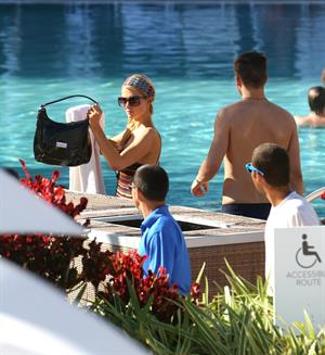 Paris Hilton poolside at their Miami hotel December 7-2012