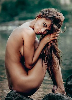 25 year old Latvian model Ilvy Kokomo posing naked outdoors in 2017.  Photographed by Saulius Ke