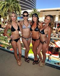 Adrianne Curry in a bikini at the Encore Beach Club in Las Vegas August 16, 2014