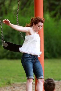 Alyson Hannigan playing in a park in Atlanta July 28, 2011