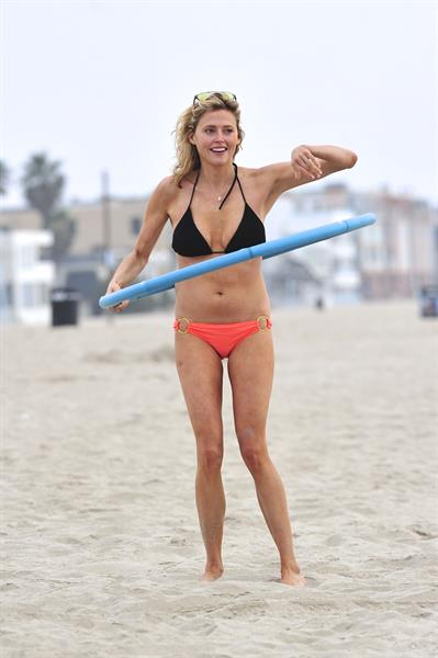Estella Warren in a bikini with a hula hoop in Venice Beach on August 12, 2014